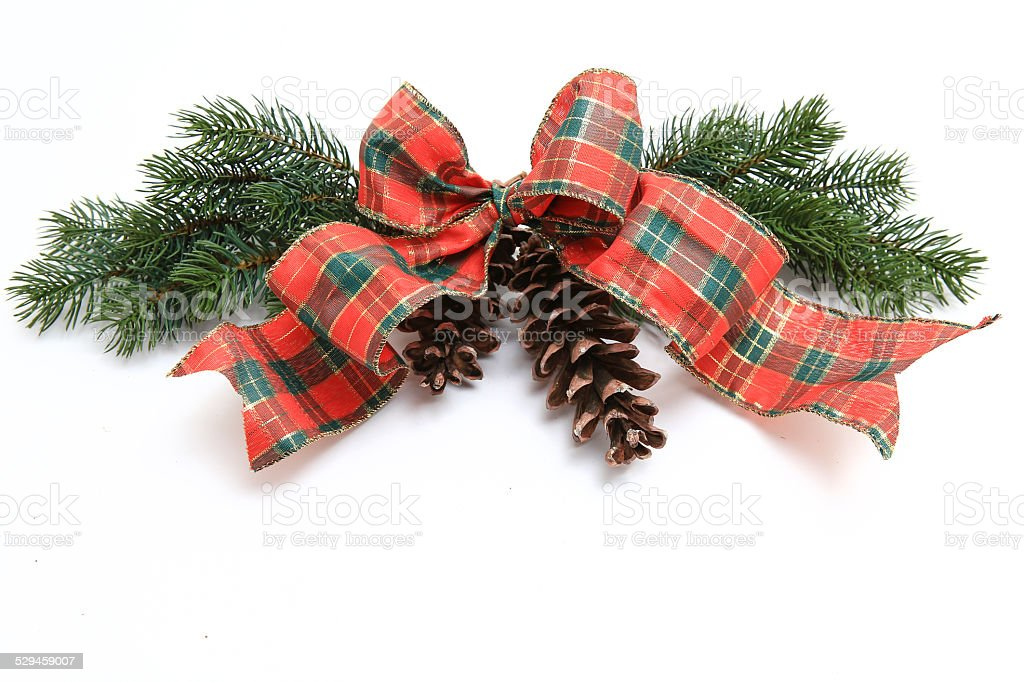 Christmas green branches with ribbon and pine cones stock photo