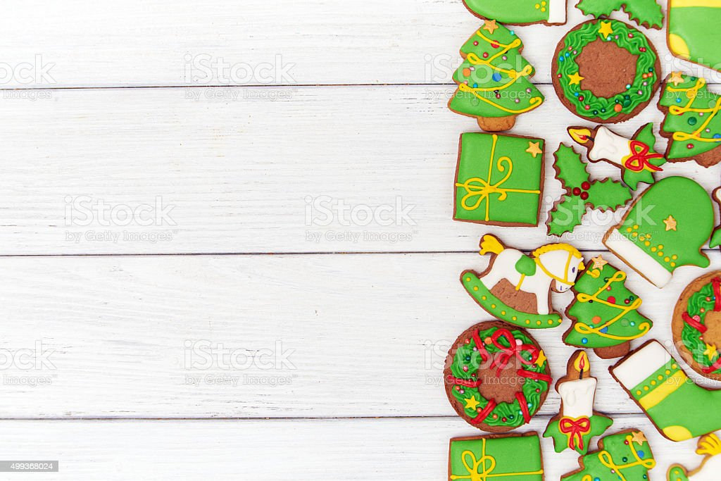 Christmas green gingerbread cookies on wooden background stock photo