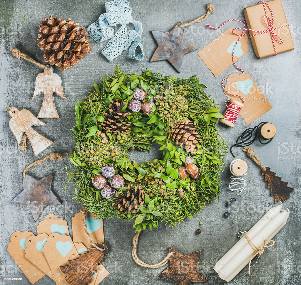 Christmas green wreath, pine cones, wooden toys, candles, decorative materials stock photo