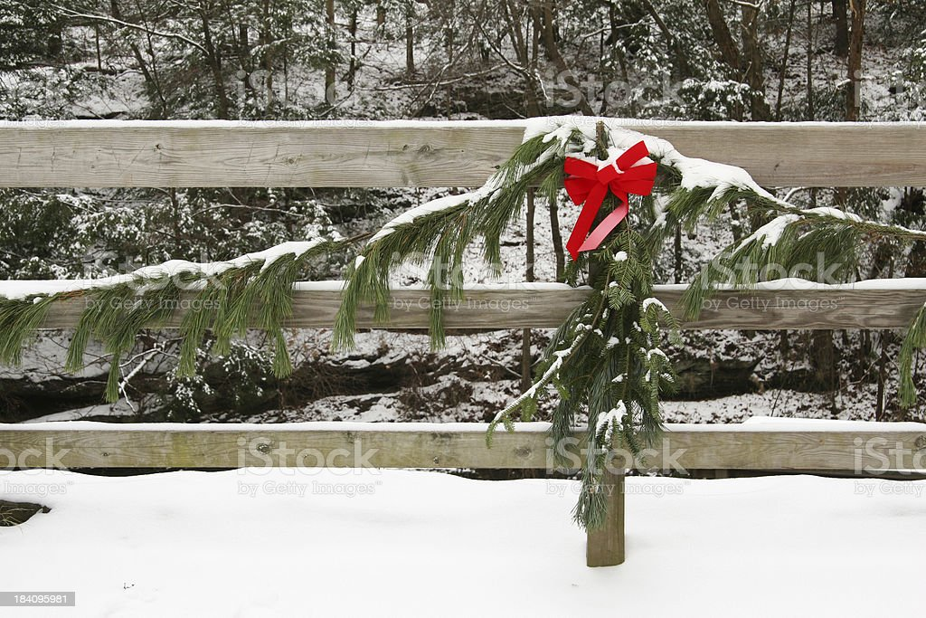 Christmas Greens With Bow On Fence - Youngstown, Ohio royalty-free stock photo