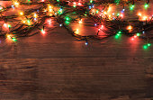 Christmas Greeting Card - Frame of Garland on wooden surface