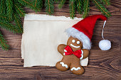 Christmas greeting card, old blank paper, gingerbread man and fir