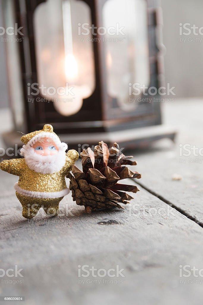 Christmas Greeting Card - Vintage Lantern, pine cone and Santa stock photo