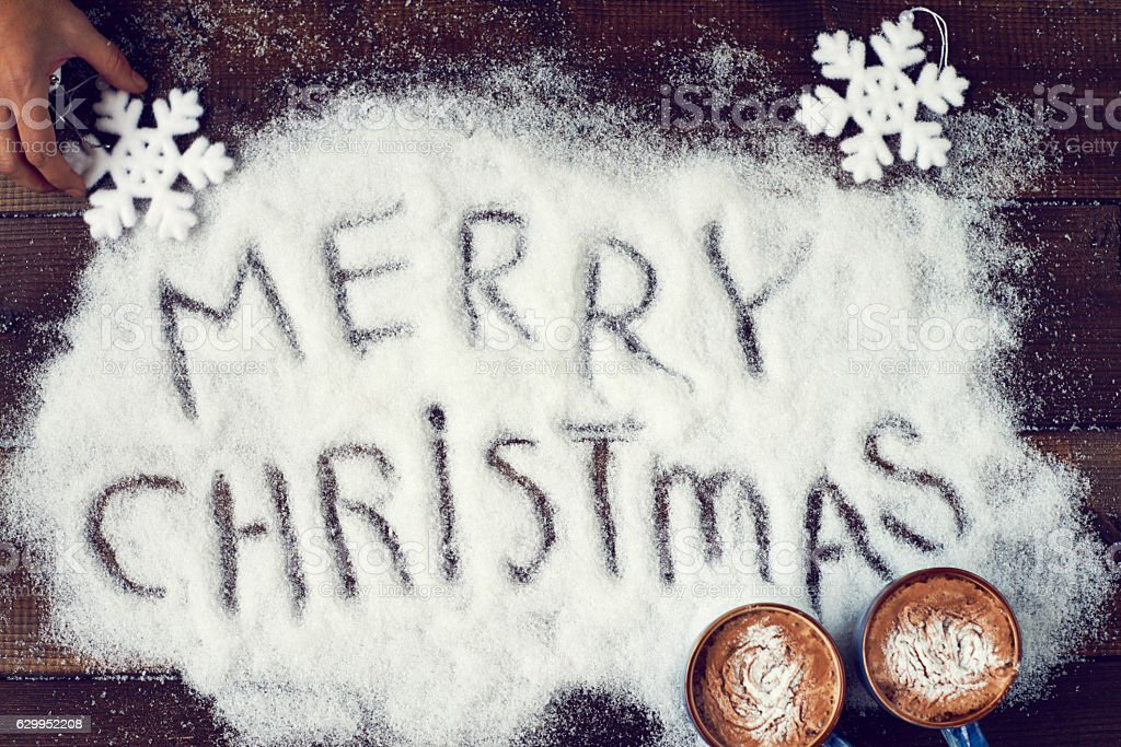 Christmas greeting written in white powder stock photo