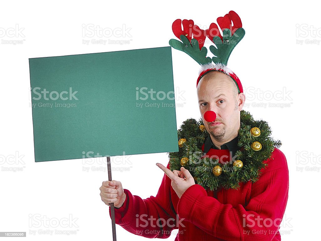 Christmas Guy Pointing at Sign royalty-free stock photo