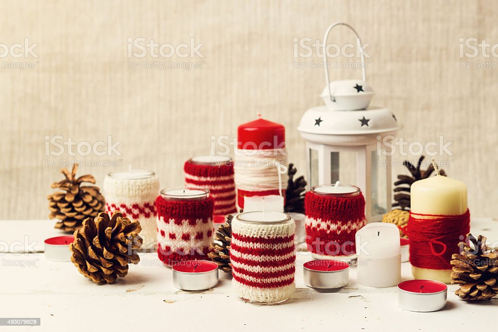 Christmas handmade. Christmas candles in the candle holders knit stock photo