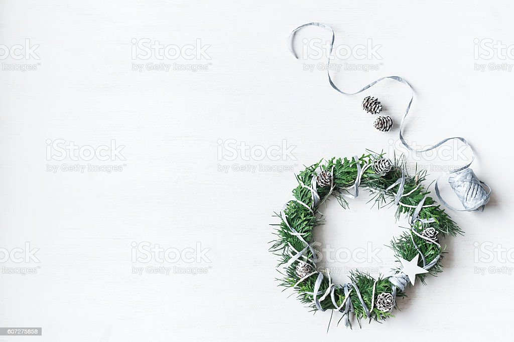 Christmas. Handmade christmas wreath. Top view, flat lay stock photo