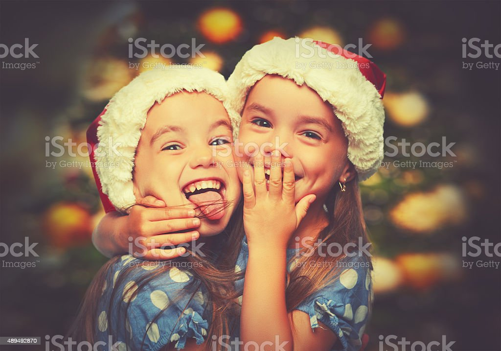 Christmas Happy funny children twins sisters stock photo