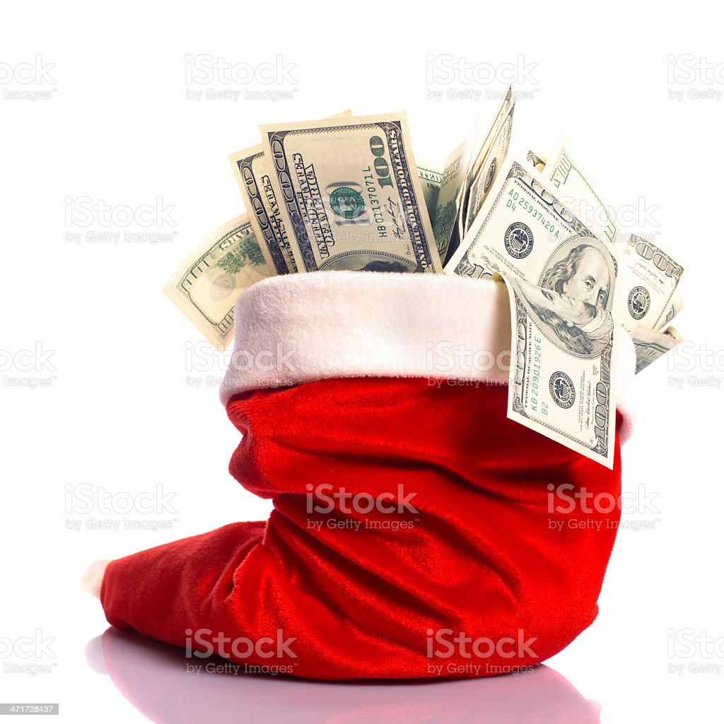 Christmas hat full of money stock photo