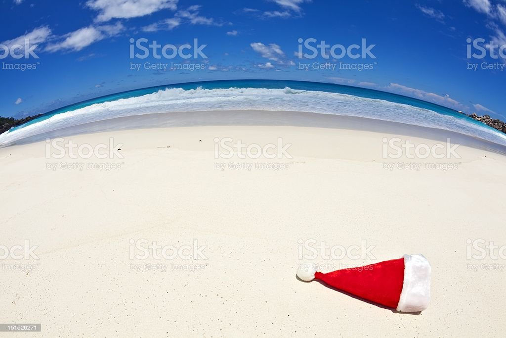 Christmas hat is on a beach royalty-free stock photo