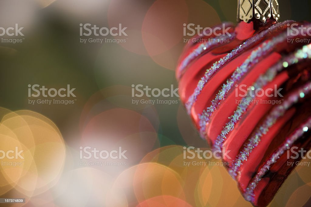 Christmas Heart Ornament Hanging in front of Light Bokeh, Copyspace royalty-free stock photo