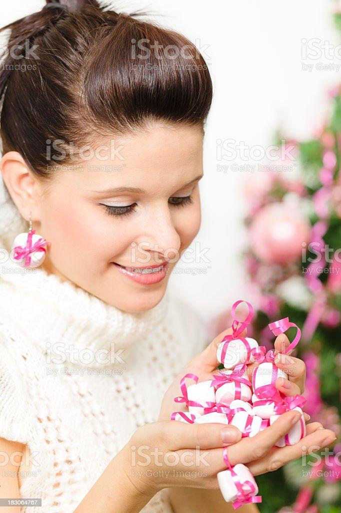 Christmas: holding candys royalty-free stock photo