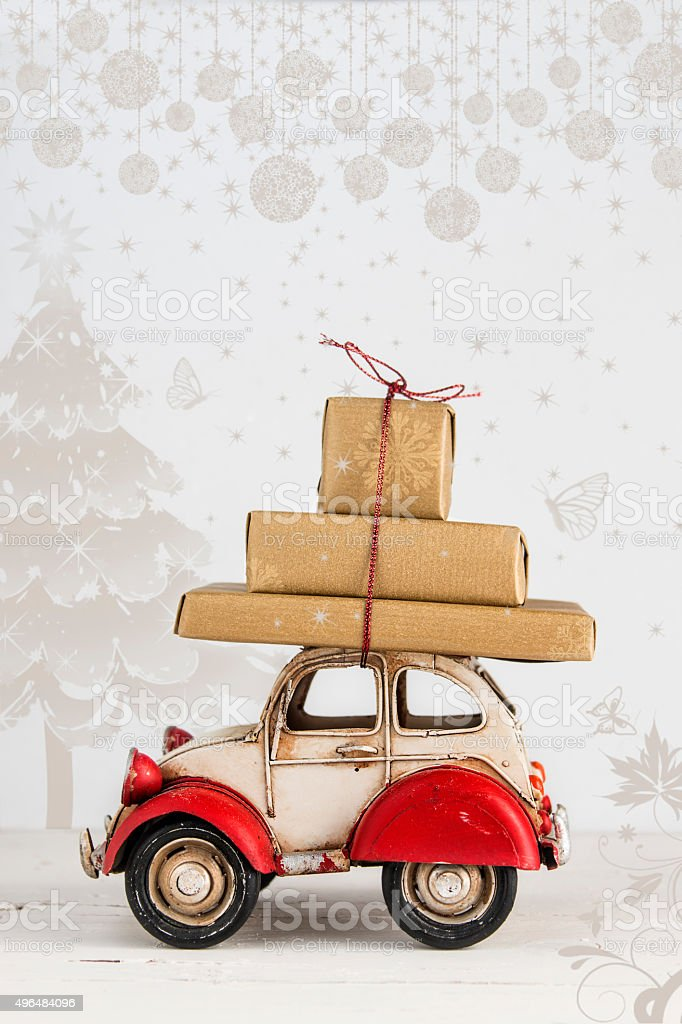 Christmas holiday card with gift boxes on toy car stock photo