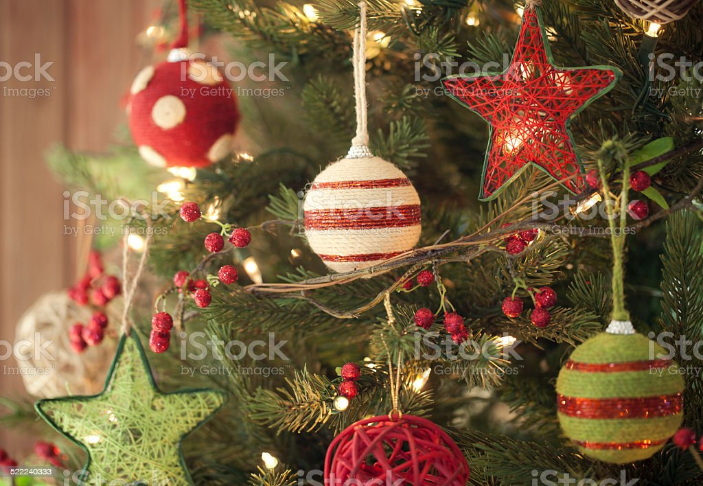 Christmas Holiday Eco friendly tree, natural ornaments, wood door stock photo