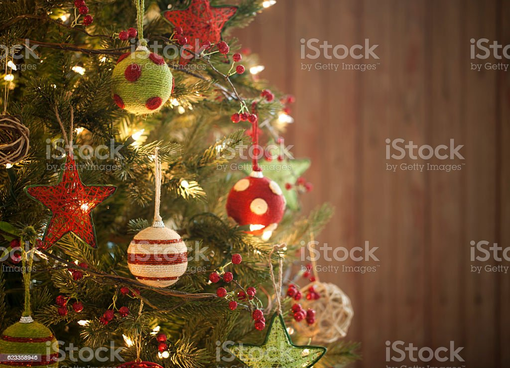 Christmas Holiday Environmentally friendly Tree, Natural Ornaments, Wood Background stock photo