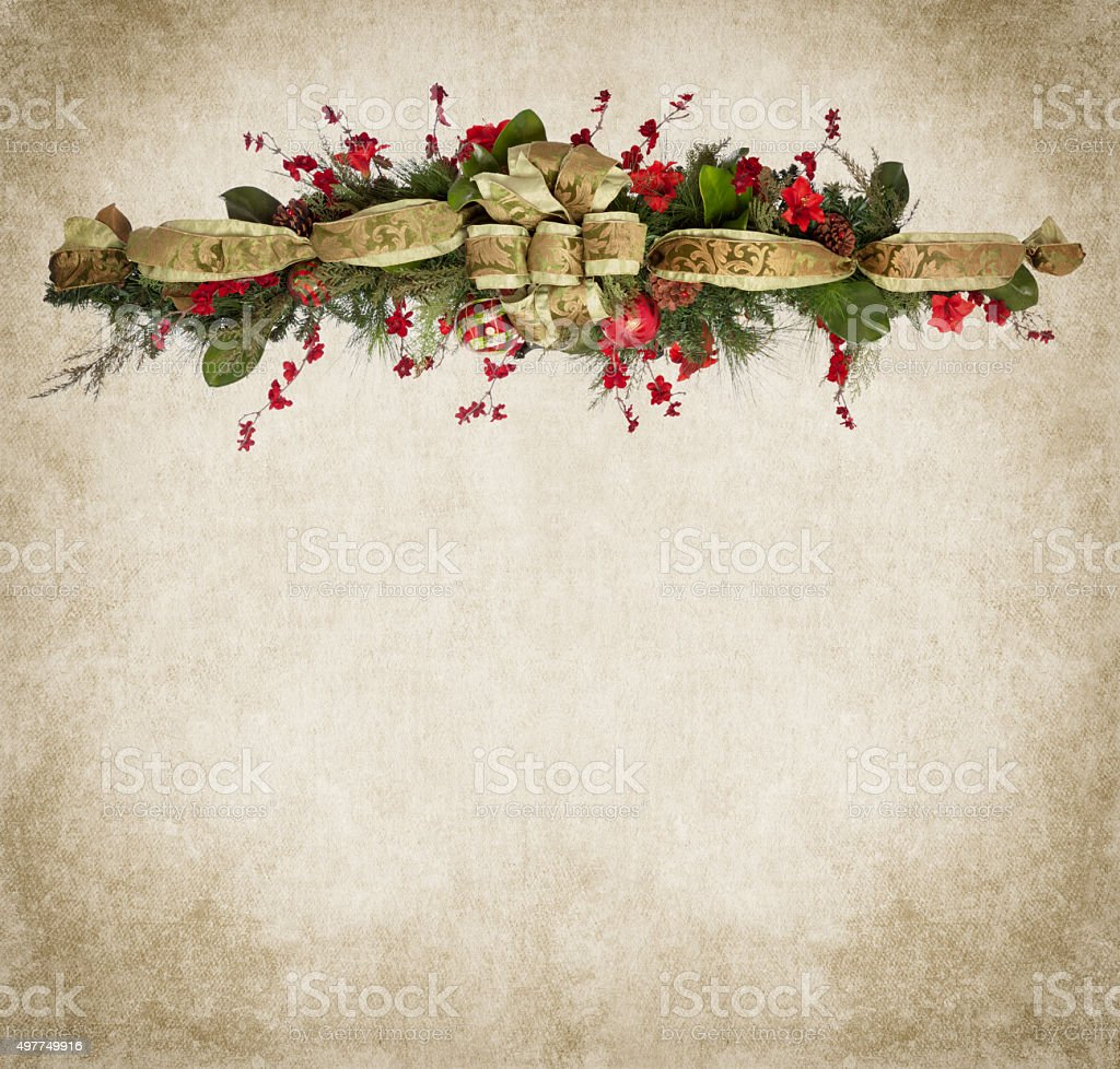 Christmas Holiday Garland with Baubles on Grunge Texture Background stock photo