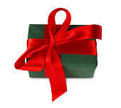 Christmas holiday gift box in green paper isolated on white