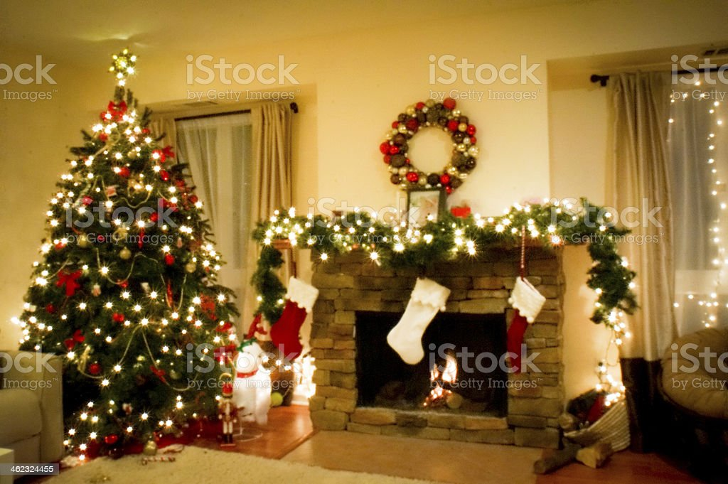 Christmas holiday living room with  tree and fireplace in lights stock photo