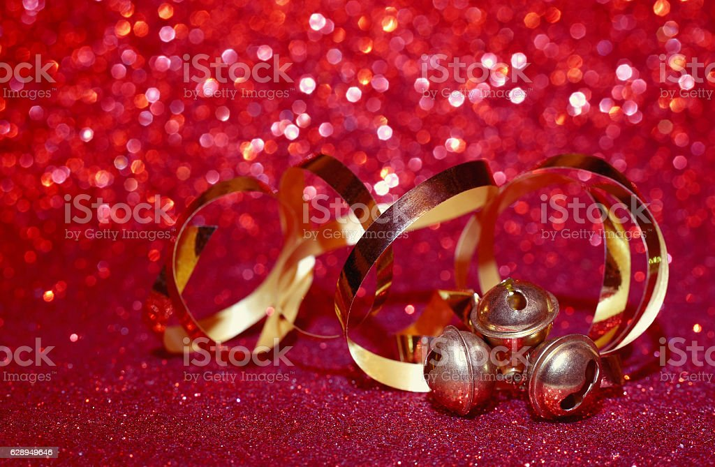 Christmas holiday red background, three small bells stock photo
