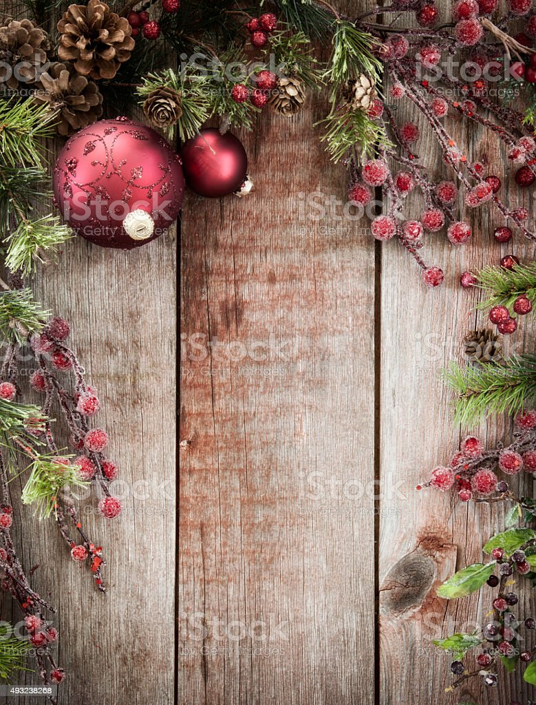 Christmas Holiday Wreath Garland Background on Old Rustic Wood stock photo
