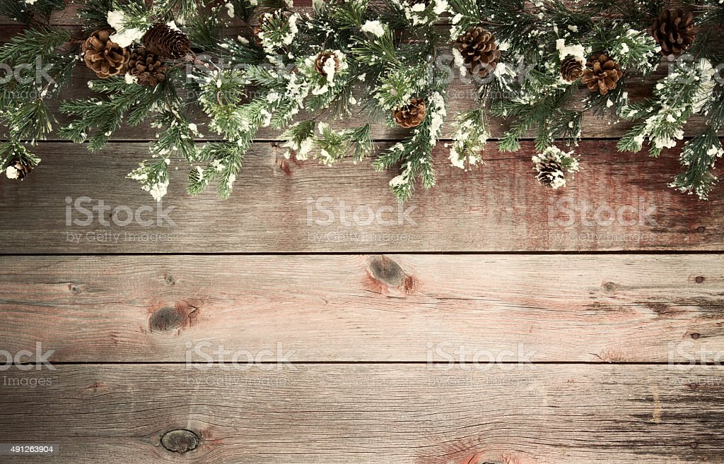 Christmas Holiday Wreath on a Wood Background stock photo
