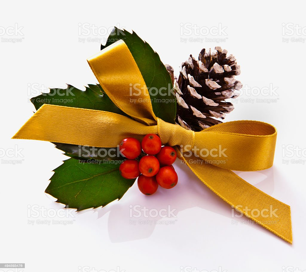 Christmas Holly, Pine cone and Ribbon stock photo