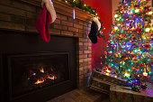 Christmas Home Fireplace with Christmas Tree and Stockings