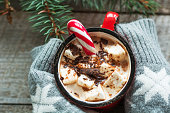 Christmas hot chocolate hold female hand.  Top view and closeup.