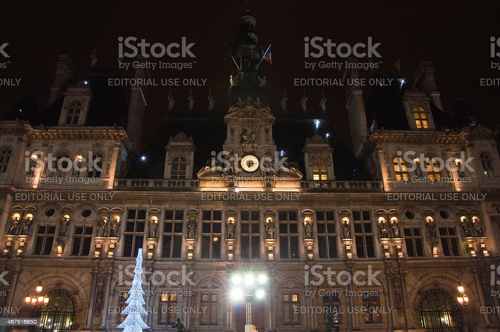 Christmas ice skating and illuminated Hotel de ville at night. stock photo
