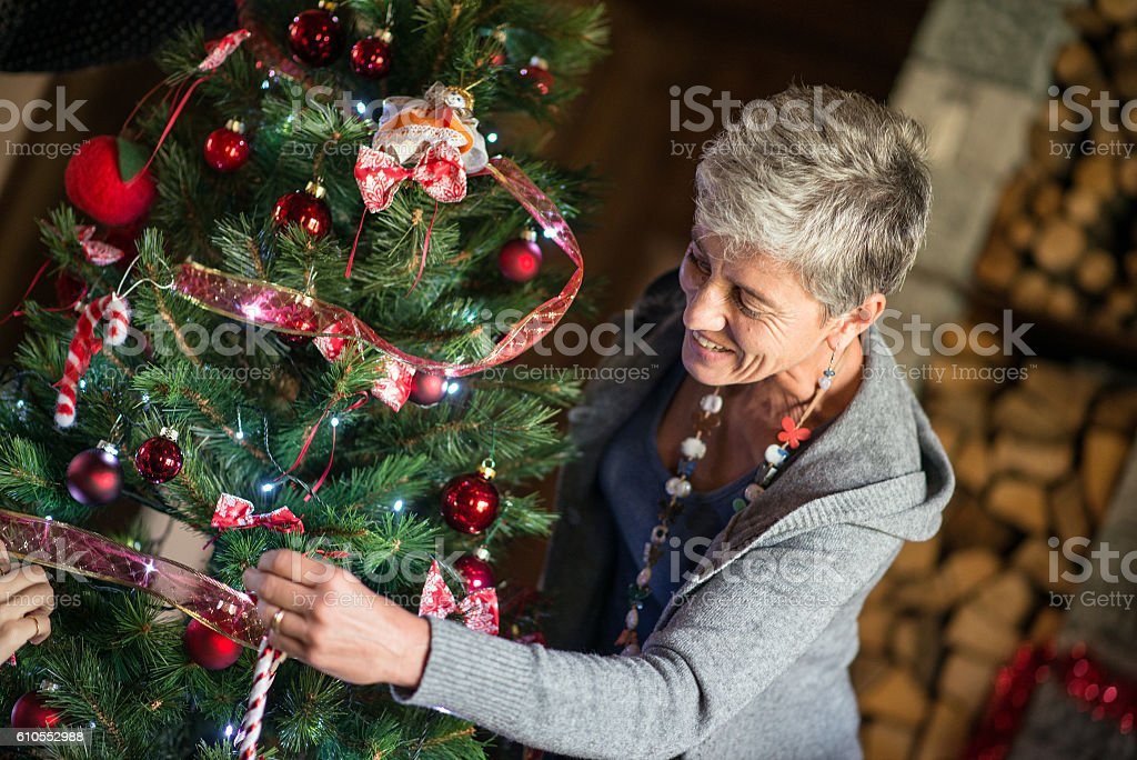 Christmas in mountain house: preparing the Christmas tree stock photo