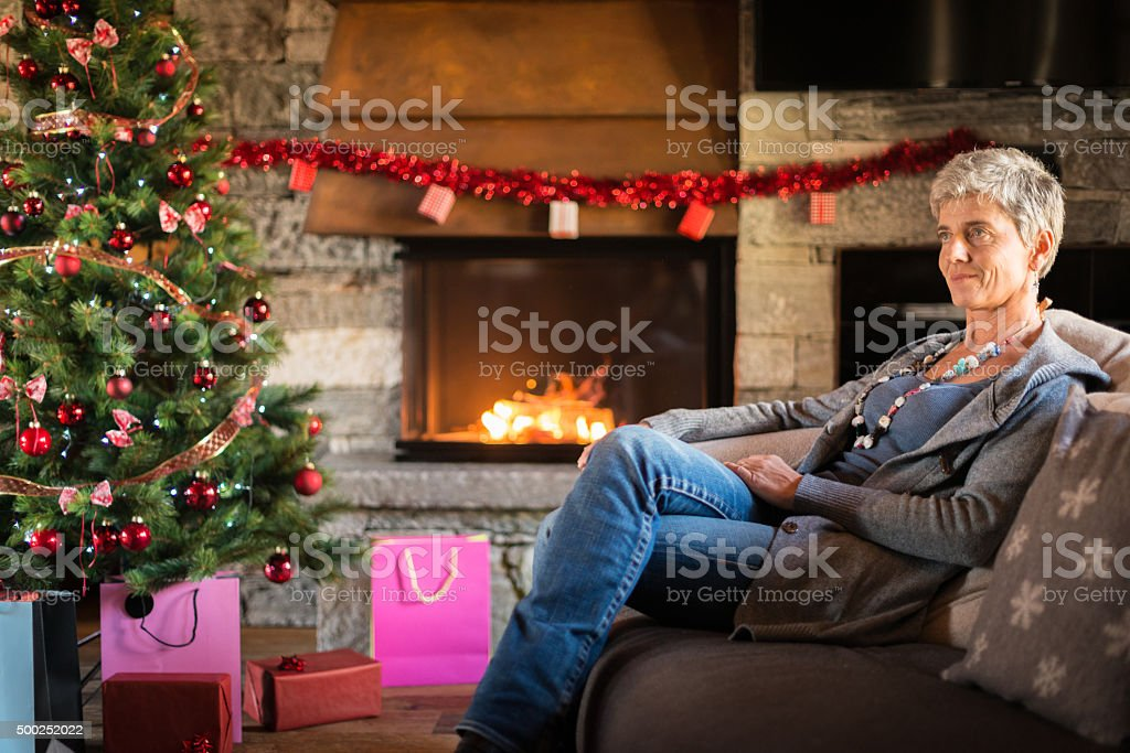 Christmas in mountain house: Woman stock photo