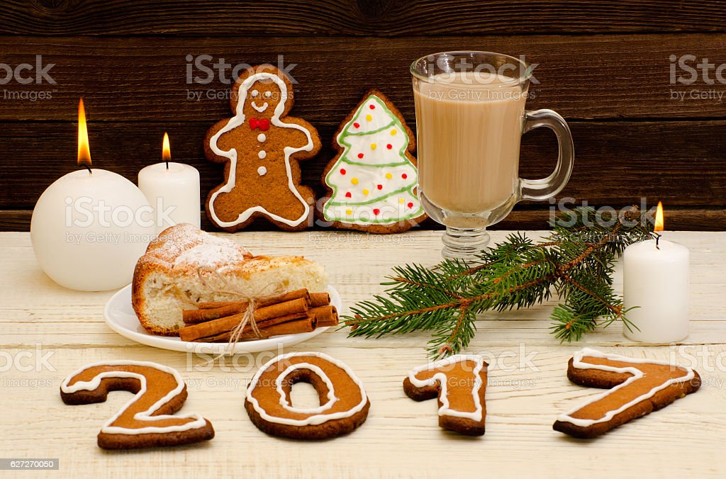 Christmas installation. Fir branch, gingerbread, pots, cake and candles stock photo