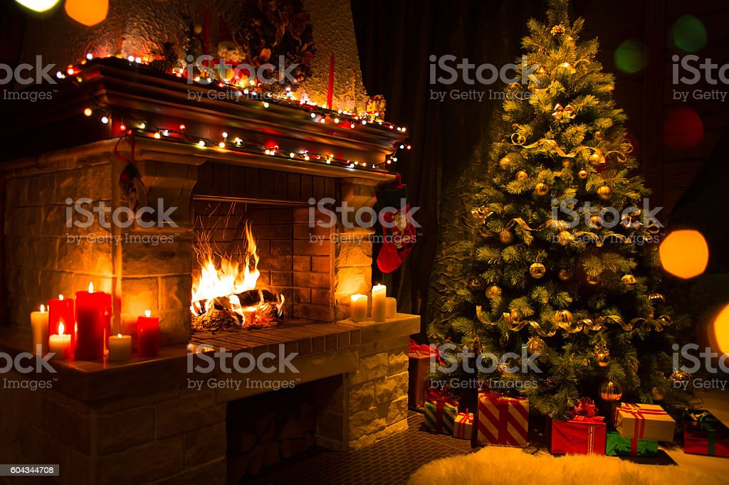 christmas interior with tree, presents and fireplace stock photo