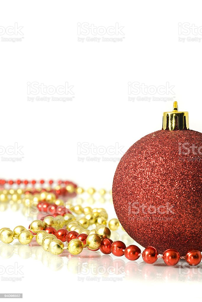 Christmas is coming. Decoration - colorful red bauble and tinsel royalty-free stock photo