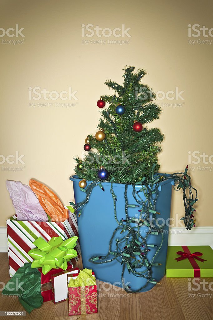 Christmas is Over - Xmas Tree in the Trash royalty-free stock photo