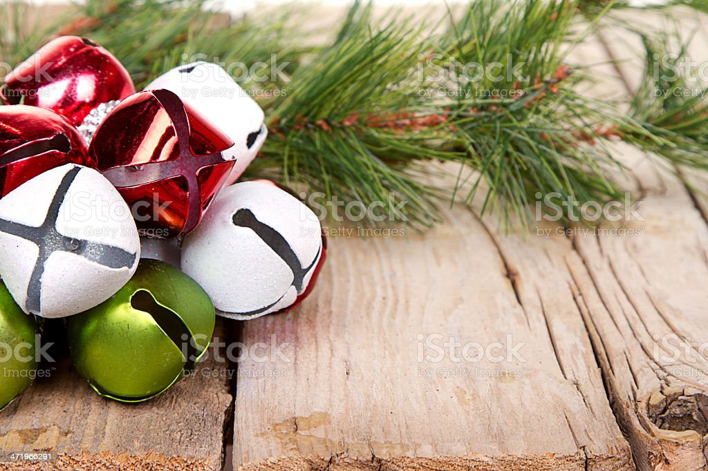 Christmas Jingle bells and a pine branch stock photo