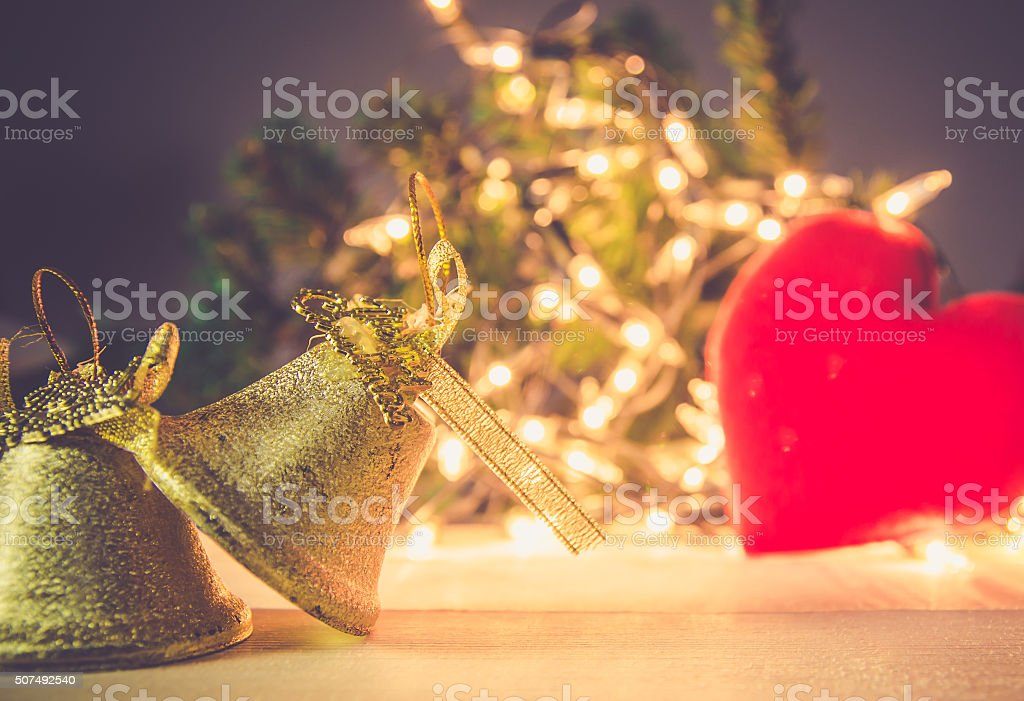 christmas , jingle golden bell deco with rusty gold light bulb stock photo