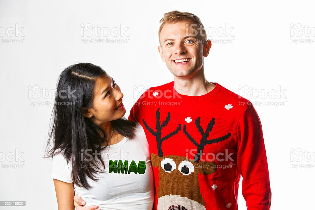 Christmas Jumpers portrait of inter racial couple stock photo