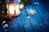 Christmas lantern in night on old wooden background