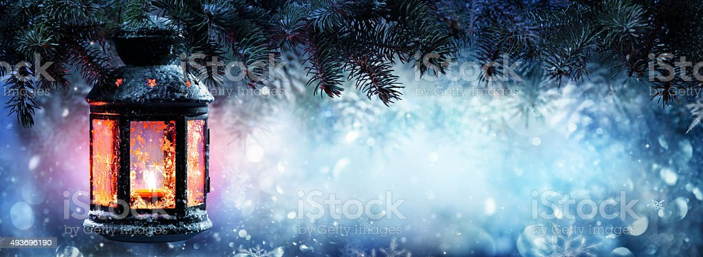 Christmas Lantern on snow With Fir Branch stock photo