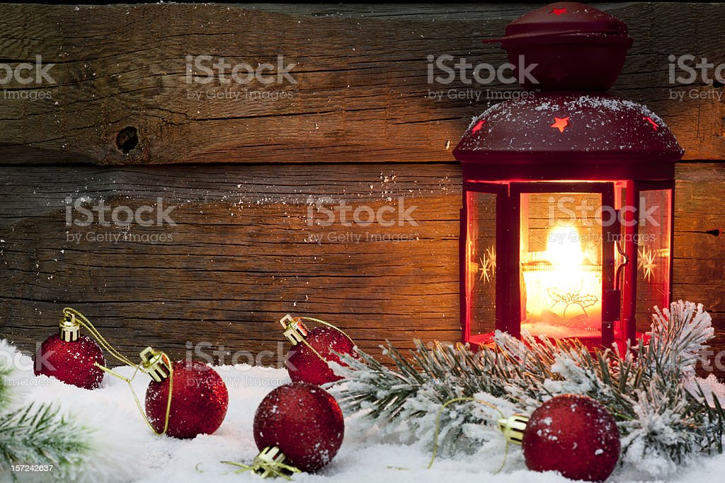 Christmas lantern with baubles on snow royalty-free stock photo