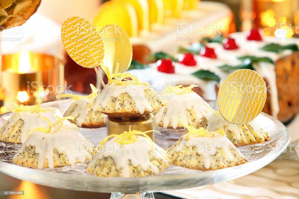 Christmas lemon poppy seed muffins on the decorated table stock photo