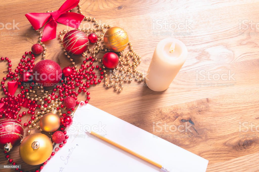 Conceptual image with a letter addressed to Santa, on a wooden table,...