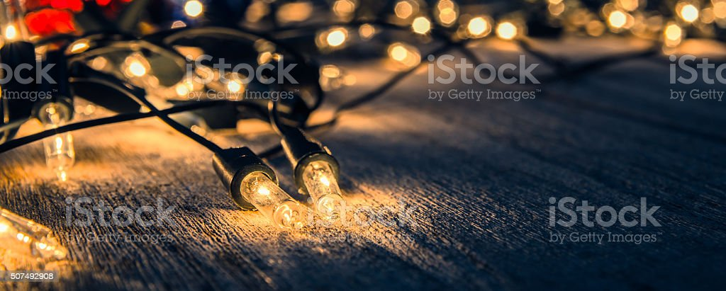christmas light decor on wood background , color filter vintage tone stock photo