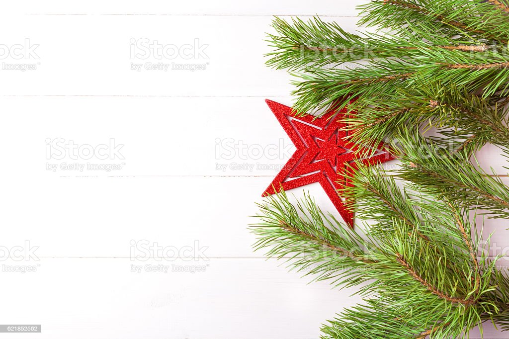 Christmas light frame decorated with red star and fir branches stock photo