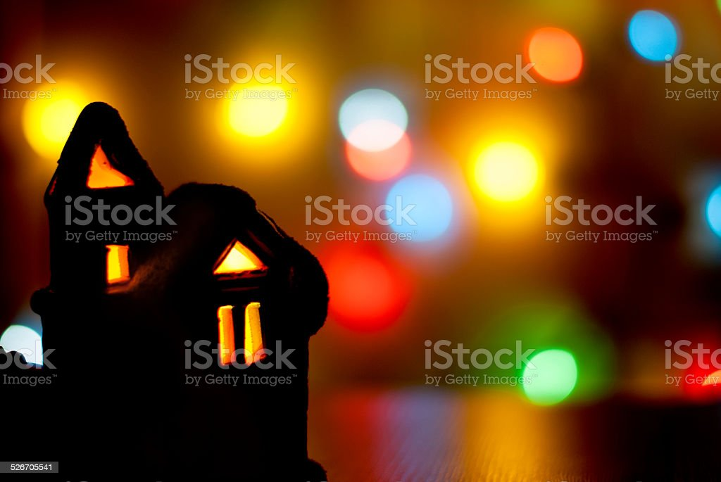 Christmas light house on a background of colorful bokeh stock photo