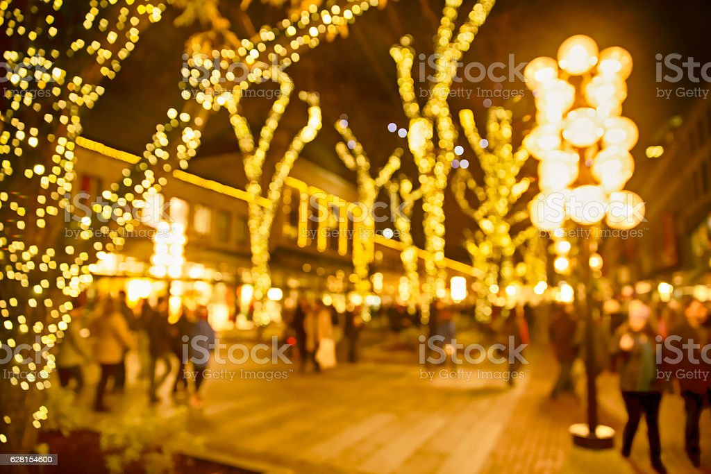 Christmas lights and people walking around on the street stock photo