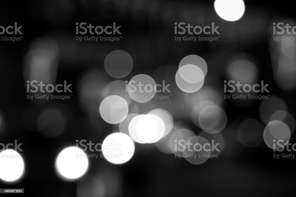 Christmas lights black and white bokeh background stock photo