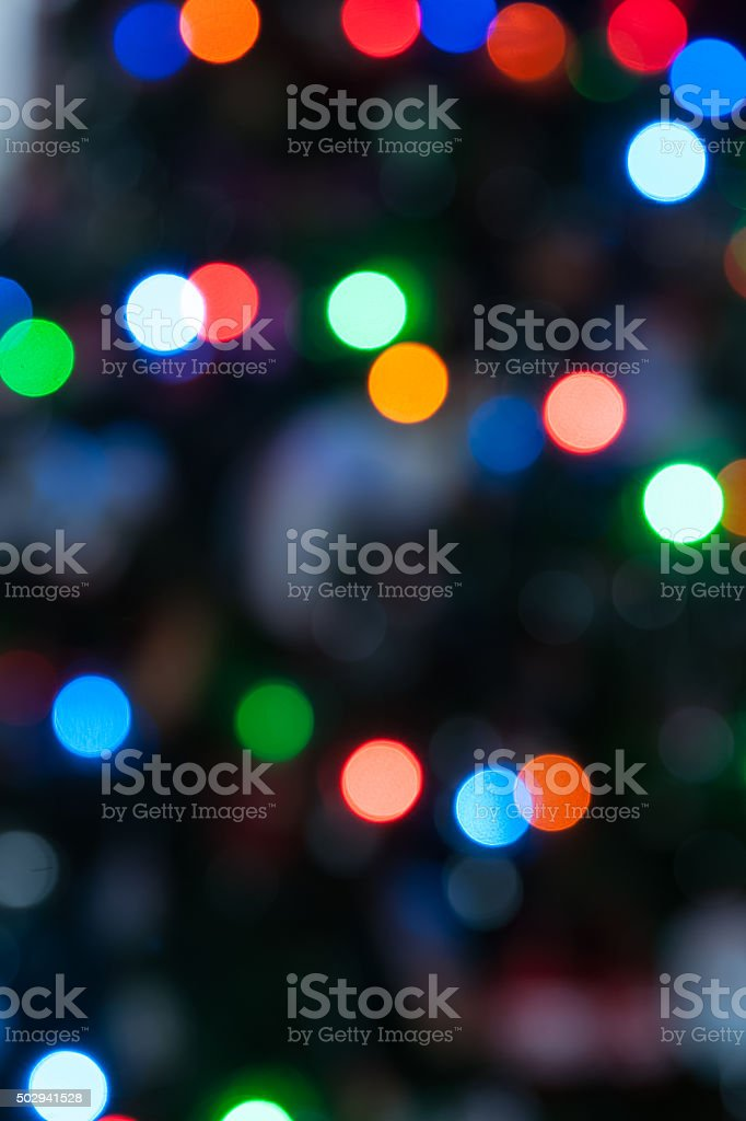 Christmas lights colorful bokeh defocused abstract pattern. stock photo