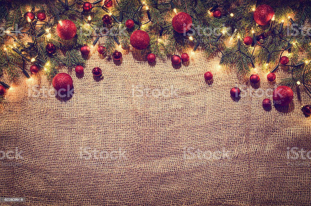 Christmas lights decoration background over linen cloth. Top view stock photo